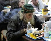 Homeless man eating meal in Loaves & Fishes Free Restaurant.