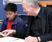 Rev. Bill Crews helping a child learn to read.