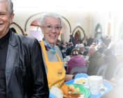Rev. Bill Crews and volunteer in Loaves & Fishes Free Restaurant.